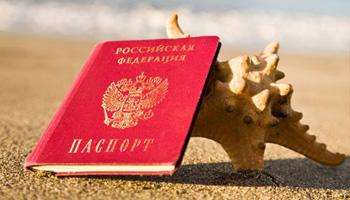 Russian passport on the beach